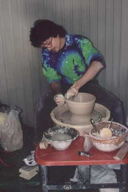 Robert throwing pottery